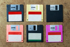 Disk or floppy disk. Floppy disk in various colors. flat lay on wood board Royalty Free Stock Photos