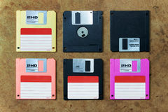 Disk or floppy disk. Floppy disk in various colors. flat lay on wood board Royalty Free Stock Photography