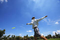 Disk golf. Player showing throwing form with blue sky royalty free stock images