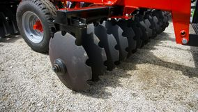 The disk harrow. Agricultural machinery for processing of the soil in the field stock photography