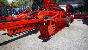 The disk harrow. Agricultural machinery for processing of the soil in the field stock photos