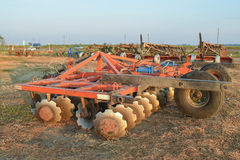 The disk harrow. Agricultural machinery for processing of the soil in the field Royalty Free Stock Photo
