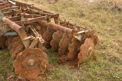 Disk harrows with soil Royalty Free Stock Image