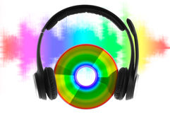 Disk and Headphones. Modern headphones on compact disc Royalty Free Stock Photos