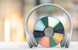 Disk with headphones on the table royalty free stock image
