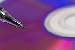 Disk with pen to the hard disk Royalty Free Stock Images