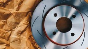 Diskettbromsen är det en del av bilbruk för stopp bilen Arkivfoto