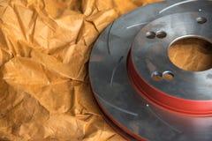 Diskettbromsen är det en del av bilbruk för stopp bilen Arkivfoton