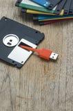 Diskettdisketter med usb-kabelproppen Royaltyfri Fotografi