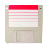 Diskette. A gray diskette with a blank red label stock photo