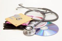Diskette-CD und -stethoskop Stockfoto