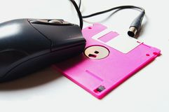 Diskette and mouse Stock Photos