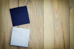 Diskette op houten vloerachtergrond Royalty-vrije Stock Foto's