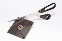 Diskette and scissors Stock Photos