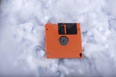 Diskette in Wolken Stockfotos