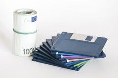 Diskettes y dinero Fotos de archivo libres de regalías