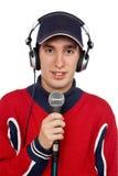 Diskjockey mit Kopfhörern und Mikrofon Stockbilder