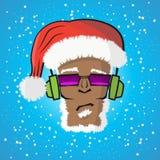 Diskjockey Santa Claus in einem Hut und in einem Kopfhörer Lizenzfreie Stockbilder