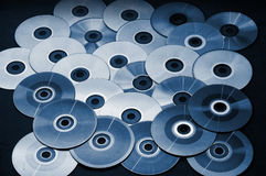 Disks. A lot of blue tone disks Stock Photos