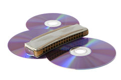 Disks and mouth-organ Royalty Free Stock Photography