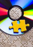 Disks on puzzles Royalty Free Stock Photo