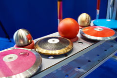 Disks, spears and cores. Subjects of athletics. Disks, spears and cores royalty free stock images