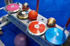 Disks, spears and cores. Subjects of athletics. Disks, spears and cores stock image