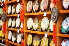 Disks of Yunnan Puer on wooden shelves at tea shop, Lijiang royalty free stock photo