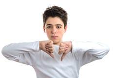 Dislike gesture by smooth-skinned Hispanic teen. Smooth-skinned Hispanic teen with acne skin in a white long sleeve t-shirt making dislike sign with both hands Stock Photo