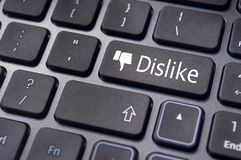 Dislike message on keyboard button, antisocial media concepts Royalty Free Stock Image