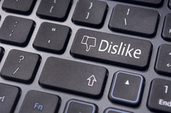 Dislike message on keyboard button, antisocial media concepts Royalty Free Stock Photography