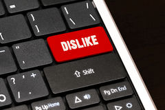 Dislike on Red Enter Button on black keyboard Royalty Free Stock Image