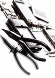 Dismantle the phone and pliers closeup Royalty Free Stock Photos