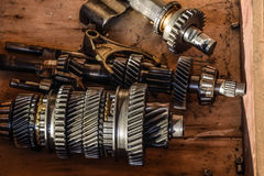 Dismantled box car transmissions. The gears on the shaft of a mechanical transmission Royalty Free Stock Image