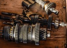 Dismantled box car transmissions. The gears on the shaft of a me Royalty Free Stock Photos