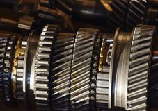 Dismantled box car transmissions. The gears on the shaft of a me Royalty Free Stock Photo