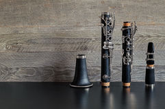 Dismantled Clarinet on a Black Table Stock Photo