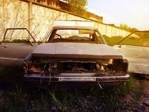 Dismantled an old rusty car on the outskirts of the dump at sunset Royalty Free Stock Photography