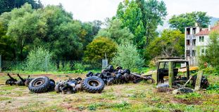 Dismantled old truck. Old trucks left to rot in a green environment. This is a car cemetery where usually second hand cars are repaired. This model is called stock photo