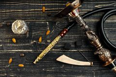 Dismantled parts of hookah on wooden background. Top view. Flat lay. Copy space. Still life Stock Photos