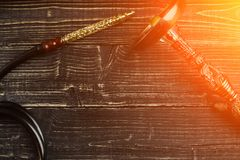 Dismantled parts of hookah on wooden background. Sun flare. Dismantled parts of hookah on wooden background. Top view. Flat lay. Copy space. Still life. Sun Royalty Free Stock Images
