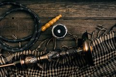 Dismantled parts of hookah on wooden background. Top view. Flat lay. Copy space. Still life Stock Image