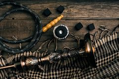 Dismantled parts of hookah on wooden background. Top view. Flat lay. Copy space. Still life Royalty Free Stock Photo