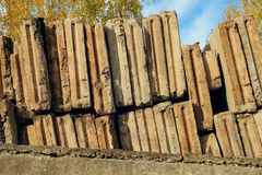 Dismantled reinforced concrete wall panels stored in tiers. At the construction site Stock Image