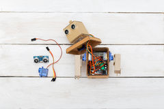 Dismantled robot and detail for robot. flat lay Royalty Free Stock Photos