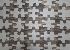A broken wooden puzzle on the table stock photo
