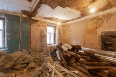 Dismantling of apartment`s interior before upgrade or remodeling, renovation, extension, restoration, reconstruction. And construction. sacks with construction Royalty Free Stock Photos