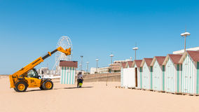 Dismantling beach huts at the end of the summer season Royalty Free Stock Photos