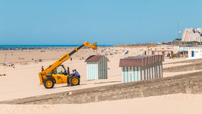 Dismantling beach huts at the end of the summer season Royalty Free Stock Images