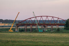 Dismantling the old bridge in the Kaluga region of Russia on the Ugra river. The Ugra river there are several large bridges on motorways. Some bridges have stock image